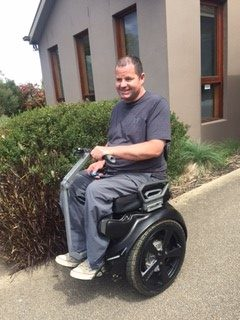 Colin Colston with Genny power chair